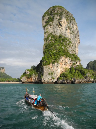 A longtail boat zips toward Railay Beach