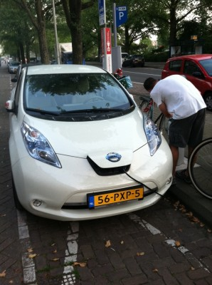 Pierre checks out an electric car charging station on an Amsterdam street.