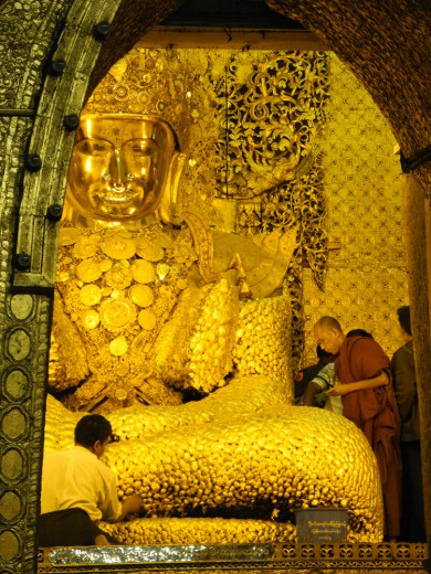 The Mahamuni Paya. The face is lovingly polished every day, and no one is allowed to stick their gold leaf there.