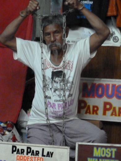 Par Par Lay shows us his handcuffs.