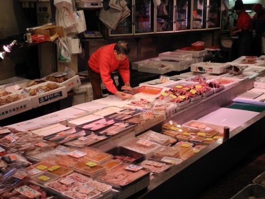 A merchant lays out some fresh seafood at the market
