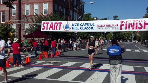 The obligatory stopping-my-watch-as-I-cross-the-finish-line shot.